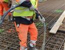 Worker using concrete vibrator