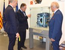 The British Ambassador to Spain, Simon Manley (left) together with Kevin Baker (middle) and Gebhard Leidenfrost (right), F4E, in front of the ITER tokamak model.