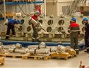 Workers at Mangiarotti S.p.A installing the forgings (in the foreground) in one of the plates (in the background).