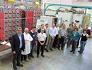 The participants of the ISEPS Factory Acceptance Tests standing in front of the equipment (Image courtesy of OCEM)