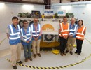 Members of the teams from F4E, ITER IO, CNIM and Douce Hydro in front of the Pre-Compression Rings tooling, CNIM, La Seyne-sur-Mer, France.