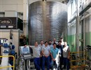 Representatives of the ICAS consortium standing in front of the spool concluding Europe's contribution the conductor for the manufacturing of the ITER Poloidal Field coils.