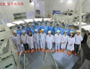 Group photo of ASIPP team celebrating the completion of the conductor winding for Poloidal Field coil six