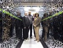 "CEA-F4E CSC team standing between a section of the ""Helios"" supercomputer: from left to right, Jacques David, François Robin, Jacques Noé (CEA) and Susana Clement Lorenzo (F4E)."