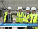 The F4E team and ITER IO Director General witness the installation of the last anti-seismic bearing