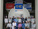 The team involved in the installation of the ACB in front of the component itself