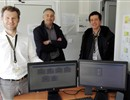 From left to right: R. Campagnolo, C. Lescure & F. Munoz standing by the monitors of the alarm survey system