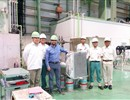 F4E's Roger Martín with representatives from Air Liquide, Sumitomo Precision Products standing next to the first 80 K loop heat exchangers