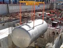 Transferring one of the bigger water detritiation tanks weighing approximately 20 tonnes in ITER's Tritium building