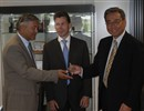 AIF Director Jérôme Paméla (left) hands over the JWS3 keys to ITER DG Kaname Ikeda (right). In the background is Laurent Schmieder, Head of the Site, Buildings and Power Supplies Division at F4E.